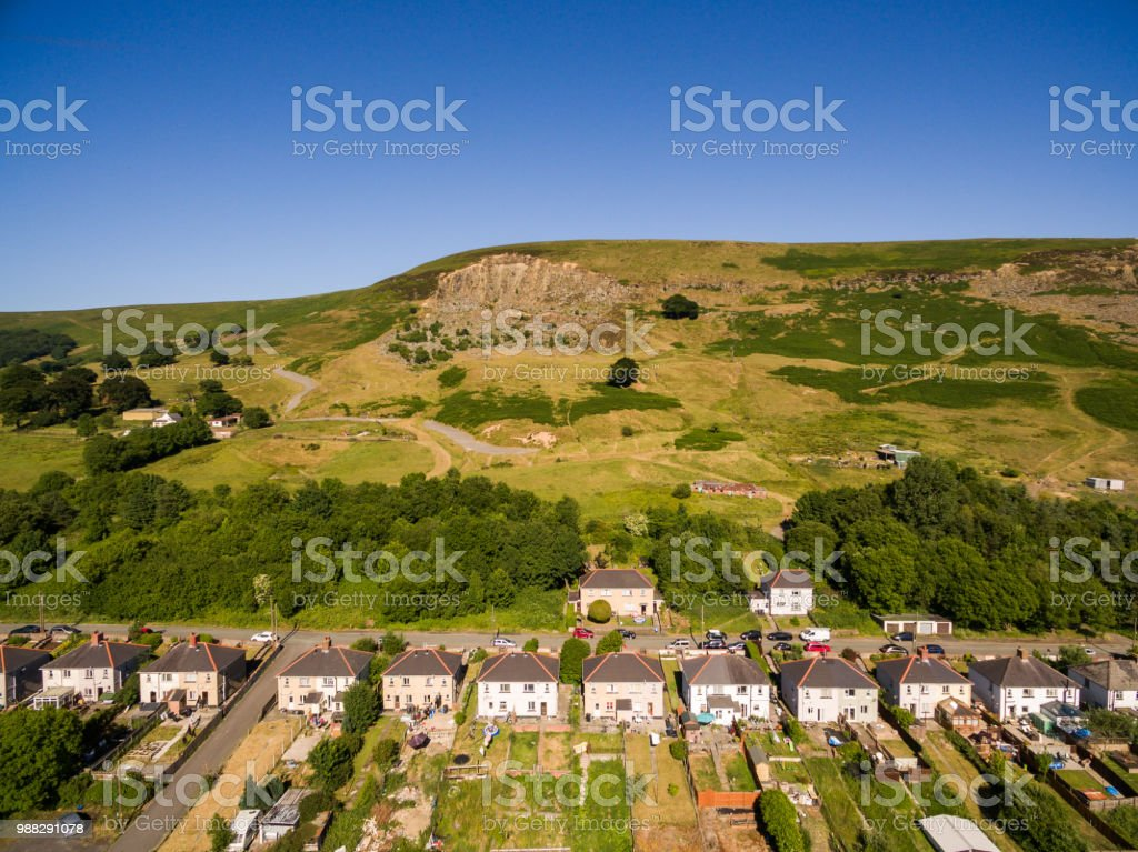 Aerial overhead view of houses in the Welsh Valley of Blaenau Gwent