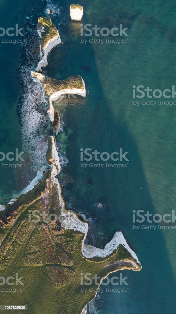 Aerial overhead views of the chalk purbeck coastline, showing coastal...