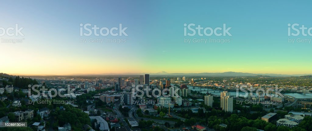 Aerial panorama at sunset of downtown Portland Oregon including 6 bridges and Mt St Helens in the distance stock photo