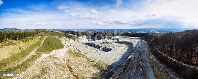 istock Aerial panorama of a quarry in Lienen-Holperdorp, Bad Iburg, Esmland, Germany 948504416