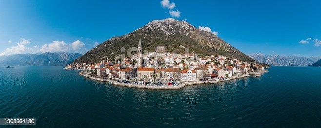 istock Aerial panorama of a sea coast, small island in the sea 1308664180