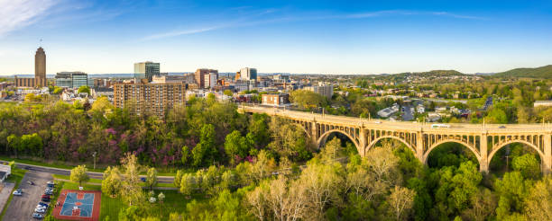 Aerial panorama of Allentown, Pennsylvania skyline Aerial panorama of Allentown, Pennsylvania skyline and Albertus L. Meyers Bridge (aka Eighth Street Bridge) on late sunny afternoon . Allentown is Pennsylvania's third most populous city. pennsylvania stock pictures, royalty-free photos & images