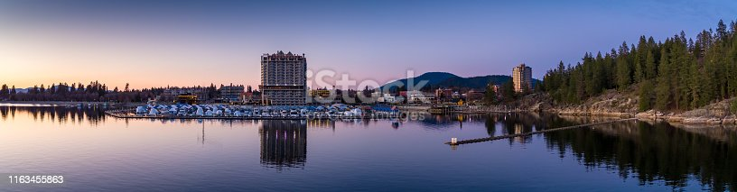 Aerial panorama of the waterfront and marina of Coeur d'Alene, Idaho at twilight.