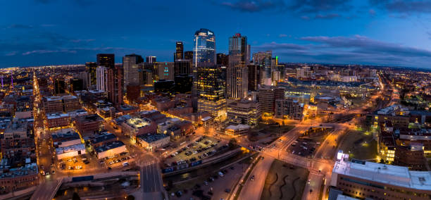 aerial panorama of denver, colorado at nightfall - halbergman stock pictures, royalty-free photos & images