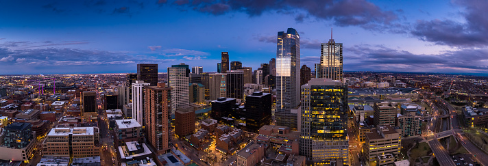 Aerial panorama of downtown Denver, Colorado at sunset.