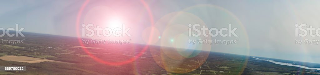 Aerial panorama of Earth's horizon with lens flare over Brockville, Ontario with the St. Lawrence River in the distance.39 stock photo