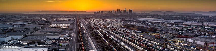 Aerial shot of an intermodal train and trucking distribution yard the city of Vernon, California. This is an industrial area surrounded by the City of Los Angeles, made up of factories, warehouses and meatpacking plants.
