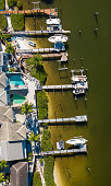 istock Aerial Panorama of Jupiter Harbour Docks and Houses 1233540199