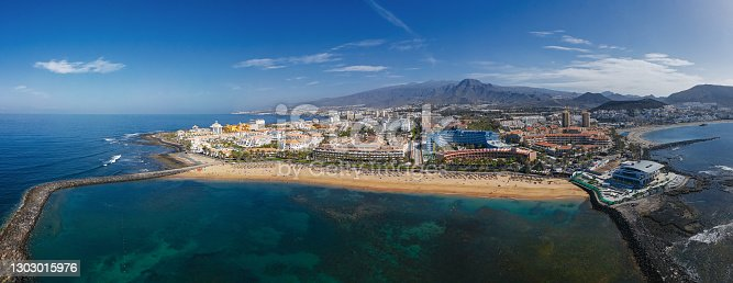 istock Aerial panorama of Los Cristianos resorts and Playa del Camison beach, Tenerife, Canary islands, Spain. 1303015976
