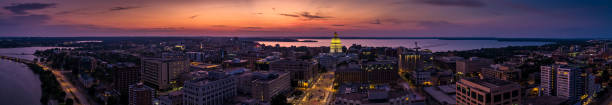 Aerial Panorama of Madison, Wisconsin at Sunset Stitched panoramic shot of the Wisconsin State Capitol building in Madison from the air. madison wisconsin stock pictures, royalty-free photos & images
