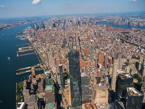 Aerial view of New York City from a helicopter on a sunny summer day.