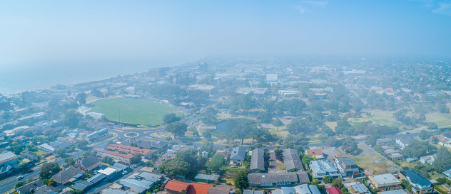 Aerial panorama of Melbourne suburbs covered in smoke haze from bush fires in Gippsland