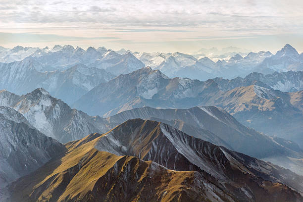 aerial panorama of mountain peaks - mountain stock photos and pictures