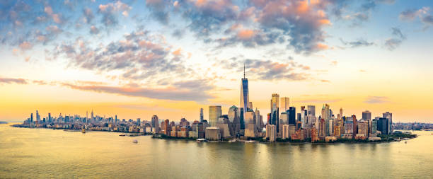 Aerial panorama of New York City skyline at sunset Aerial panorama of New York City skyline at sunset with both midtown and downtown Manhattan new york state stock pictures, royalty-free photos & images