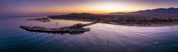 Aerial Panorama of Santa Barbara, CA at Dusk Aerial shot of the Santa Barbara Pier at sunset. santa barbara california stock pictures, royalty-free photos & images