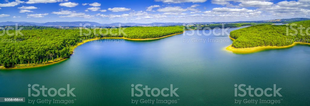 Aerial panorama of scenic lake and surrounding forest stock photo