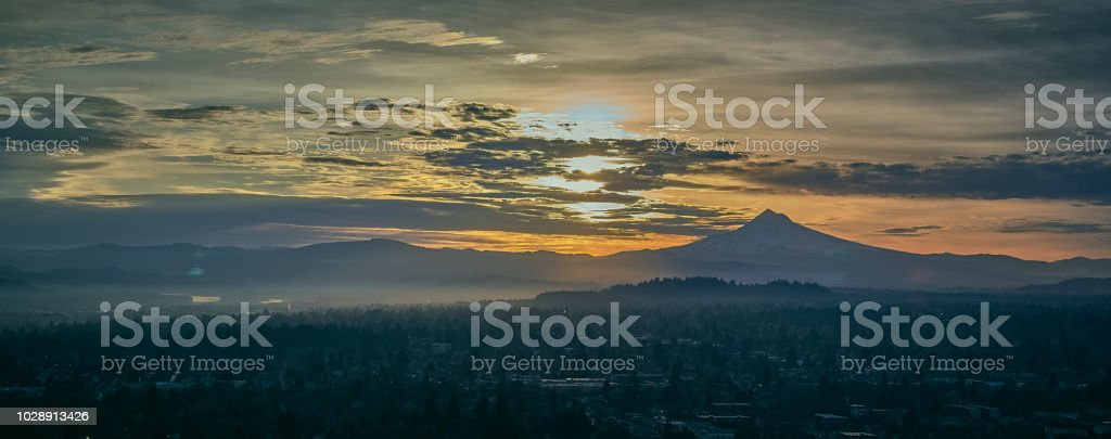 Aerial panorama of sunrise over Mt. Hood on a cold winter morning in Portland Oregon stock photo