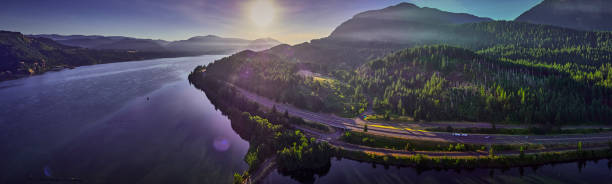 Aerial Panorama of the Columbia River and surrounding forest and hills rising up from the river the morning in the Columbia River Gorge stock photo