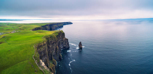 aerial panorama of the scenic cliffs of moher in ireland - cliffs of moher stock pictures, royalty-free photos & images