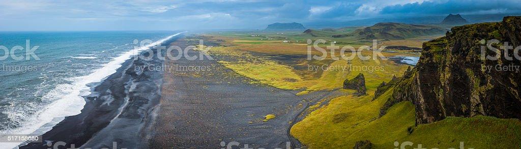 Aerial panorama over black beach wild Arctic Ocean surf Iceland stock photo