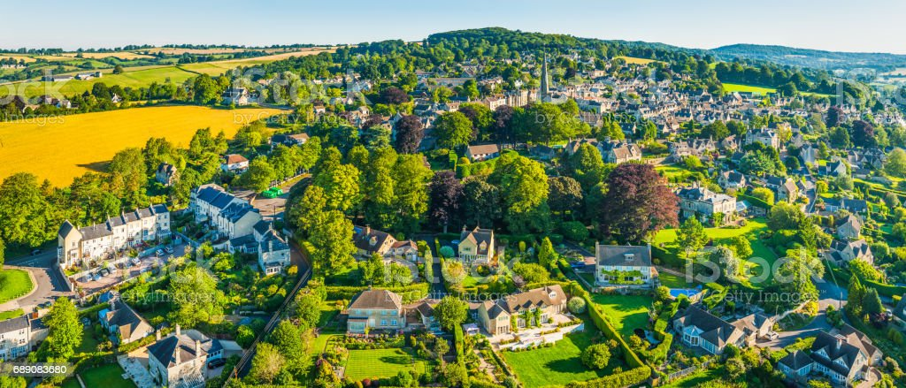 Aerial panorama over country homes in picturesque summer village Cotswolds stock photo