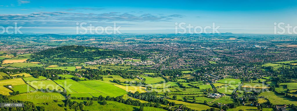 Aerial panorama over country town green fields and suburban housing stock photo