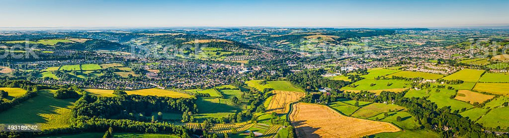 Aerial panorama over country town green fields Stroud Valley England stock photo