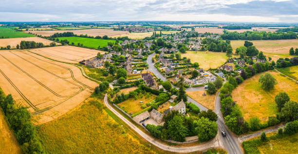 Aerial panorama over country village homes fields farms and pasture stock photo