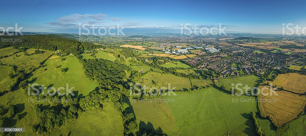 Aerial panorama over green countryside homes suburbs and town UK stock photo