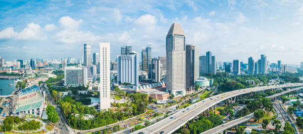 Aerial panorama over highrise highways skyscraper cityscape Marina Bay Singapore stock photo