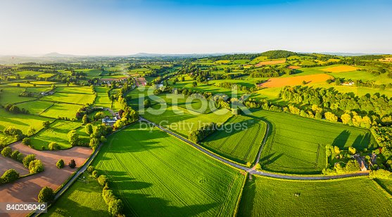 istock Aerial panorama over idyllic green summer farm fields crops pasture 840206042