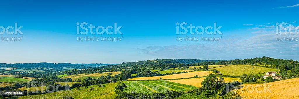 Aerial panorama over patchwork quilt green landscape farms fields villages stock photo
