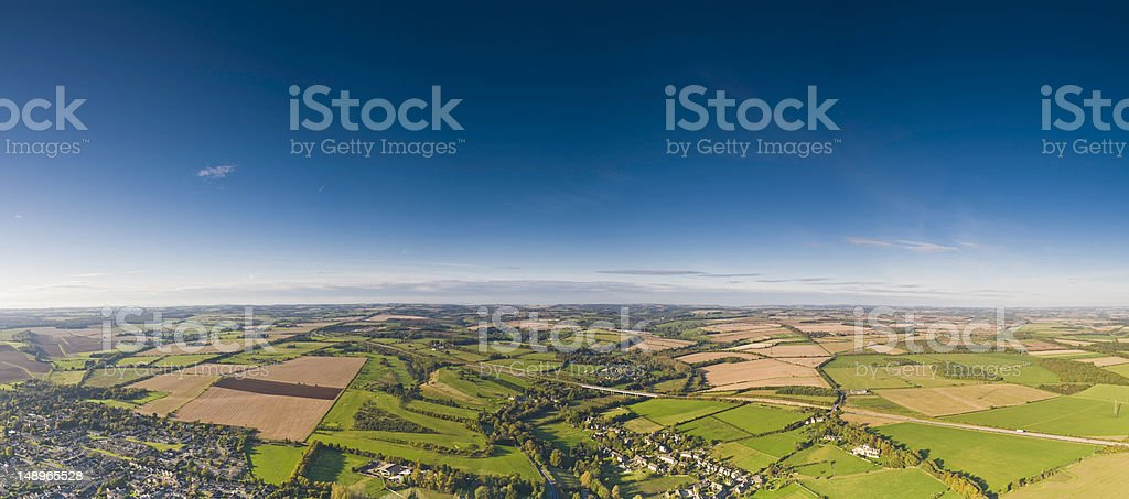 Aerial panorama patchwork land villages big sky royalty-free stock photo