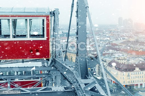 aerial panoramic citiscape view of Vienna from top of Prater amusement fair park ferris wheel during snowfall on cold snowy day. Winter Vienna holiday travel background.