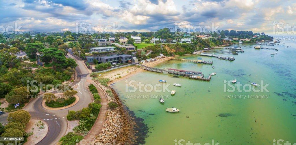 Aerial panoramic landscape of Sorrento suburb coastline with private piers and moored boats. Mornington Peninsula, Melbourne, Australia stock photo