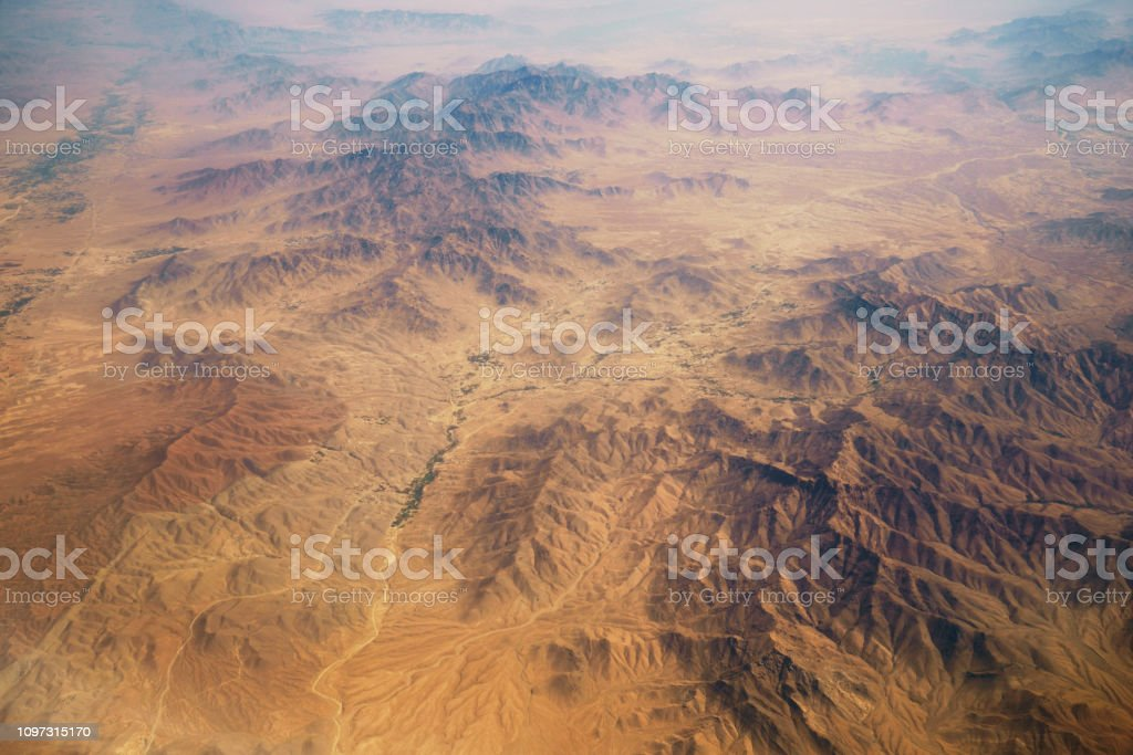 aerial panoramic view at canyons in desert from airplane above pakistan stock photo