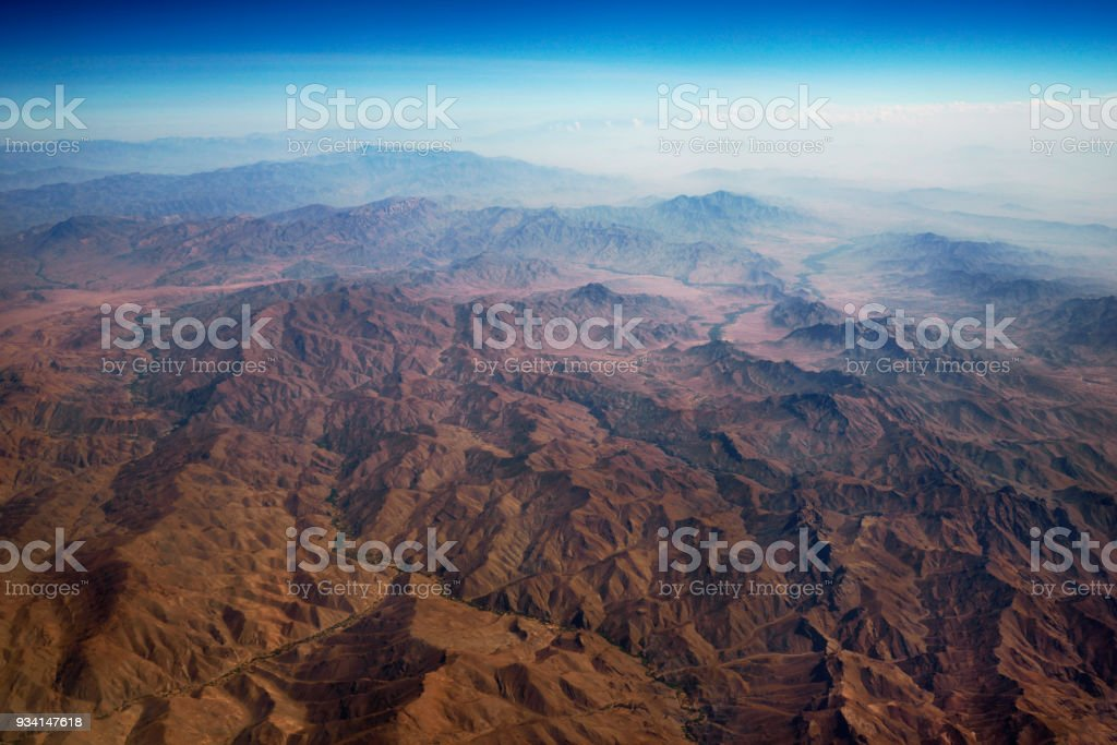 aerial panoramic view at mountain range from airplane above afghanistan stock photo