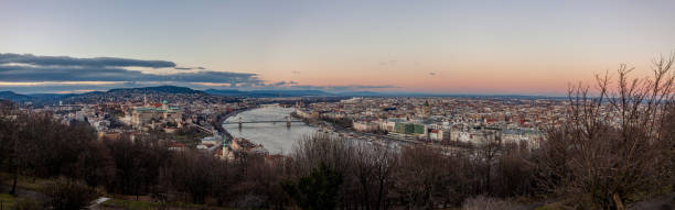 Aerial panoramic view Budapest, Hungary by sunset. Buda castle, Chain bridge and Parliament building stock photo