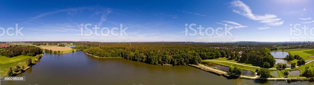 Aerial panoramic view of a small lake in the district of Buechenbach of the city of Erlangen Aerial panoramic view of a small lake in the district of Buechenbach of the city of Erlangen, Bavaria - Germany Bavaria Stock Photo