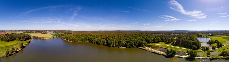 Aerial Panoramic View Of A Small Lake In The District Of Buechenbach Of The City Of Erlangen Stock Photo - Download Image Now