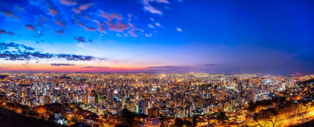 Aerial Panoramic View of Belo Horizonte During Sunset Colored Aerial Panoramic View of Belo Horizonte Cityscape, Minas Gerais State, Brazil. Image taken from Water Tank Viewpoint during Sunset with a Multicolored Sky and Buildings with some Lights already on. high dynamic range imaging stock pictures, royalty-free photos & images