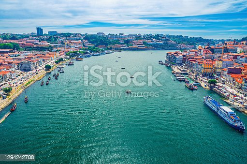 Aerial panoramic view of Porto Oporto city historical centre with Douro River with boats between Ribeira district and Vila Nova de Gaia town, Norte or Northern Portugal