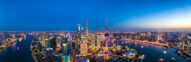 Aerial panoramic view of Shanghai city skyline at dusk panoramic View of the splendid aerial night view of downtown, Shanghai.drone point of view.Panoramic photo huangpu district stock pictures, royalty-free photos & images