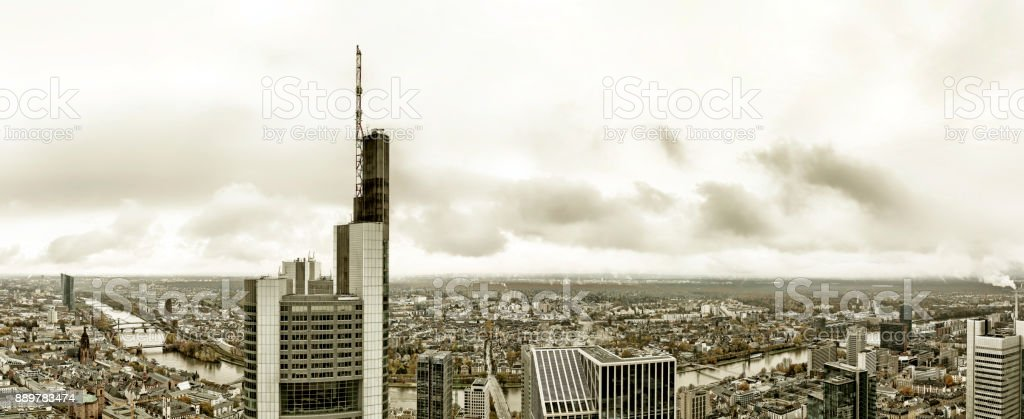 Aerial panoramic view of the Frankfurt am Main skyline with Commerzbank, European Central Bank and the Dom with moody sky stock photo