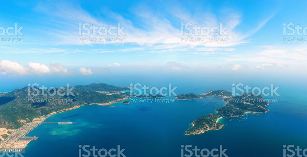 Aerial panoramic view of the sea harbor among the islands. stock photo