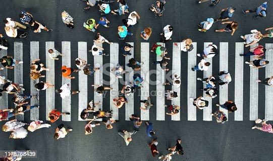 Aerial. Pedestrians on pedestrian crosswalk. Top view.