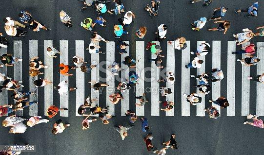 istock Aerial. Pedestrians on pedestrian crosswalk. Top view. 1175768439