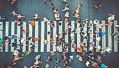 istock Aerial. People crowd on pedestrian crosswalk. Top view background. Toned image. 1180279584