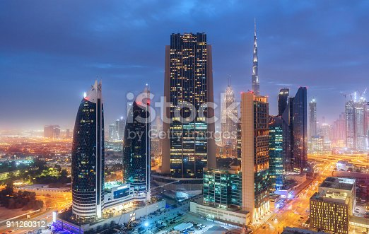 istock Aerial perspective of downtown Dubai, UAE. Multicolored travel background. 911260312