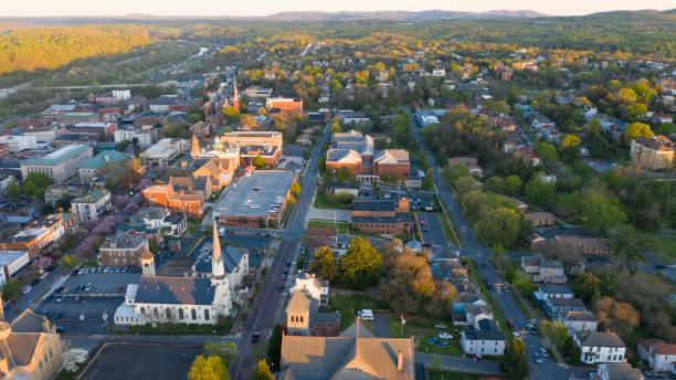 aerial perspective over downtown lynchburg virginia at days end - небольшой город стоковые фото и изображения